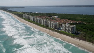 AX0019_003 - 5K stock footage aerial video row of beachside apartment buildings in Port St. Lucie, Florida