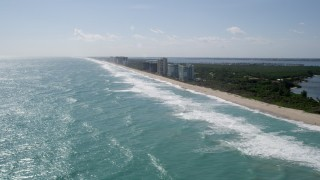 AX0019_005 - 5K stock footage aerial video approach row of beachside apartment buildings in Jensen Beach, Florida