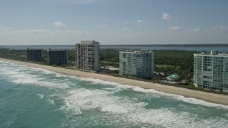 AX0019_006 - 5K stock footage aerial video of passing apartment buildings in Jensen Beach, Florida