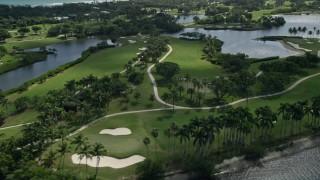 AX0019_018E - 5K stock footage aerial video flyby Jupiter Island Golf Club in Hobe Sound, Florida