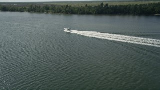 AX0019_022 - 5K stock footage aerial video of fishing Boat on the Indian River near Hobe Sound in Florida