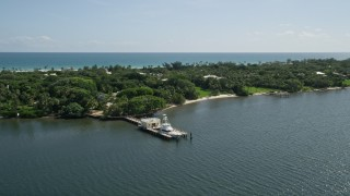 AX0019_023 - 5K stock footage aerial video of docked fishing boat on the Indian River by Hobe Sound, Florida