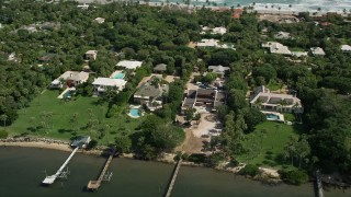 AX0019_024 - 5K stock footage aerial video of upscale homes beside the Indian River in Hobe Sound, Florida