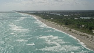 AX0019_030 - 5K stock footage aerial video of beach near homes in Hobe Sound, Florida