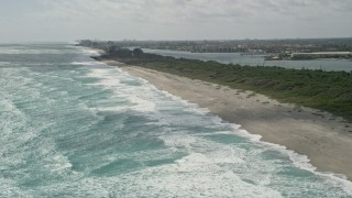 AX0019_032 - 5K stock footage aerial video fly over ocean waves by Tequesta Beach in Florida
