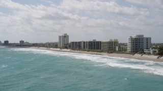 AX0019_035 - 5K stock footage aerial video of row of beachfront apartment buildings in Tequesta, Florida