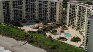 AX0019_038 - 5K stock footage aerial video of a beachfront condominium complex in Jupiter, Florida