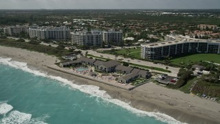 AX0019_040 - 5K stock footage aerial video of oceanfront resort on the beach in Jupiter, Florida
