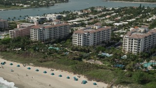 AX0019_051 - 5K stock footage aerial video of oceanfront hotel and beach at Palm Beach Shores, Florida