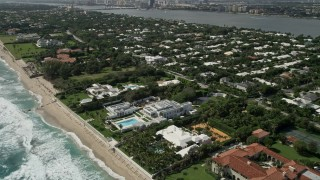 AX0019_055 - 5K stock footage aerial video fly over and tilt to oceanfront mansions in Palm Beach, Florida