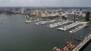 AX0019_059 - 5K stock footage aerial video of a marina by the bridge in West Palm Beach, Florida