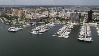 AX0019_060 - 5K stock footage aerial video of passing a marina by the waterfront in West Palm Beach, Florida