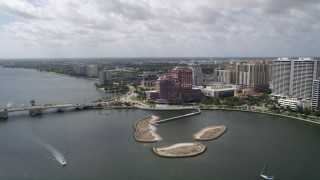 AX0019_061 - 5K stock footage aerial video approach lakefront commercial property in West Palm Beach, Florida