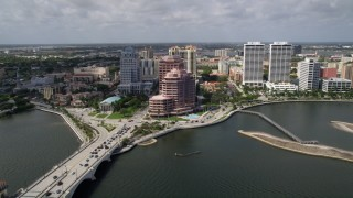AX0019_062 - 5K stock footage aerial video flyby lakefront office building and bridge in West Palm Beach