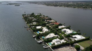AX0019_065 - 5K stock footage aerial video of waterfront island mansions in Palm Beach, Florida