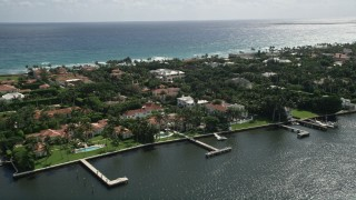 AX0019_067 - 5K stock footage aerial video flyby lakefront mansions with docks in Palm Beach, Florida