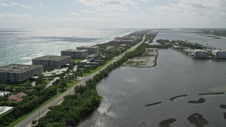 AX0019_071 - 5K stock footage aerial video of oceanfront office buildings by a Lakeside Road in Palm Beach, Florida