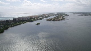 AX0019_073 - 5K stock footage aerial video approach lakefront mansions on a small island on Lake Worth in Palm Beach, Florida