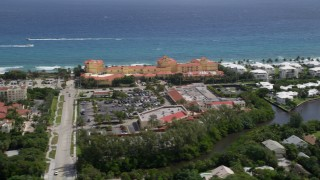 AX0019_077 - 5K stock footage aerial video reveal oceanfront hotels and condominiums in Manalapan, Florida