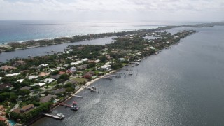 AX0019_078 - 5K stock footage aerial video of lakefront mansions with docks on an island in Manalapan, Florida