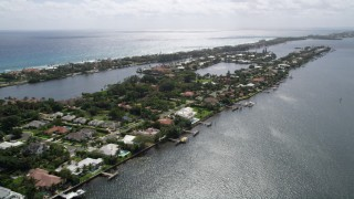 AX0019_079 - 5K stock footage aerial video flyby waterfront mansions on a small island in Manalapan, Florida