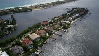 AX0019_080 - 5K stock footage aerial video flyby a narrow island with large, waterfront mansions in Manalapan, Florida
