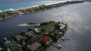 AX0019_081 - 5K stock footage aerial video of lakefront mansions at end of small island in Manalapan, Florida