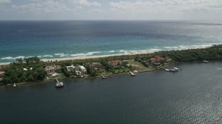 AX0019_082 - 5K stock footage aerial video of a row of lakeside mansions with docks in Manalapan, Florida