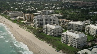 AX0019_087 - 5K stock footage aerial video approach oceanfront condominiums and beach in Delray Beach, Florida