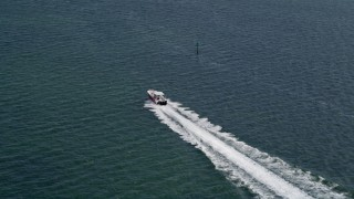 AX0020_006 - 5K stock footage aerial video of tracking a speedboat cruising across Biscayne Bay, Florida