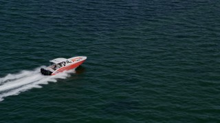 AX0020_008 - 5K stock footage aerial video track speedboat racing across Biscayne Bay, Florida