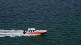 AX0020_009 - 5K stock footage aerial video track speedboat cutting through the blue water of Biscayne Bay, Florida