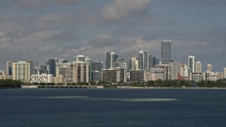 AX0020_010 - 5K stock footage aerial video tilt from the bay to reveal the Downtown Miami skyline in Florida