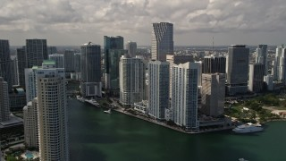 AX0020_025 - 5K stock footage aerial video flyby Brickell Key skyscrapers to reveal Miami River through Downtown Miami, Florida