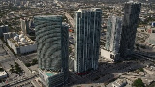 AX0020_030 - 5K stock footage aerial video of four tall skyscrapers in Downtown Miami, Florida