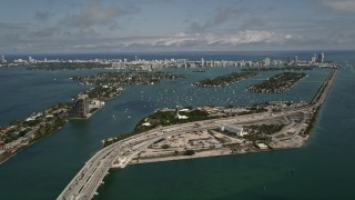 AX0020_031 - 5K stock footage aerial video of MacArthur Causeway and Watson Island on the coast in Biscayne Bay, Florida