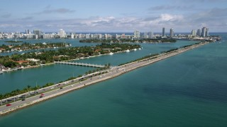 AX0020_036 - 5K stock footage aerial video flyby the MacArthur Causeway spanning Biscayne Bay in Miami, Florida