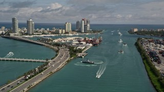 AX0020_039 - 5K stock footage aerial video pan from ferries in Government Cut to skyscrapers in South Beach, Florida