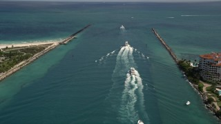 AX0020_042 - 5K stock footage aerial video approach a line of ferries sailing on Government Cut in Miami, Florida