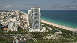 AX0020_043 - 5K stock footage aerial video orbit modern beachfront skyscrapers in South Beach, Florida