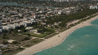AX0020_064 - 5K stock footage aerial video approach beachfront homes with ocean views in Miami Beach, Florida