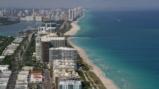 AX0020_067 - 5K stock footage aerial video of beachfront condos and hotels in Bal Harbour, with a view to Sunny Isles Beach, Florida