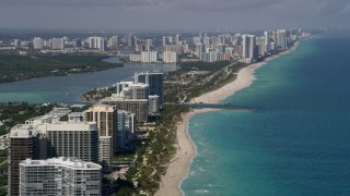 AX0020_068 - 5K stock footage aerial video of Sunny Isles Beach seen from oceanfront hotels and condos in Bal Harbour, Florida