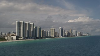 AX0020_073 - 5K stock footage aerial video of oceanfront skyscrapers along the coast in Sunny Isles Beach, Florida