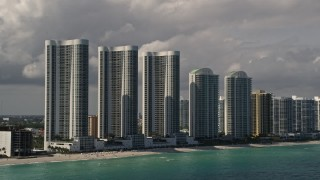AX0020_074 - 5K stock footage aerial video of Trump Towers skyscrapers on the shore of Sunny Isles Beach, Florida