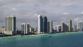 AX0020_075 - 5K stock footage aerial video of oceanfront high-rises along the beach in Sunny Isles Beach, Florida