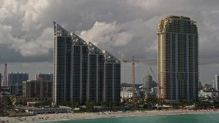 AX0020_078 - 5K stock footage aerial video of oceanfront condominium high-rise and resort hotel in Sunny Isles Beach, Florida
