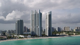 AX0020_079 - 5K stock footage aerial video of luxury resort hotels on the beach in Sunny Isles Beach, Florida