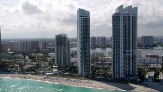 AX0020_081 - 5K stock footage aerial video of beachfront luxury high-rise resort hotels on the shore of Sunny Isles Beach, Florida
