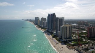 AX0020_084 - 5K stock footage aerial video of approaching beachfront high-rises in Sunny Isles Beach, Florida